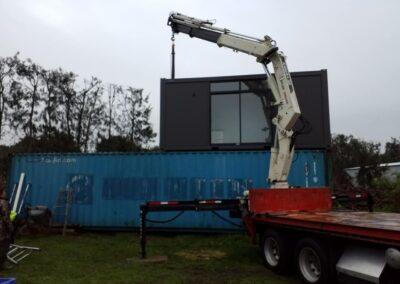 Moving containers to Matakana Island
